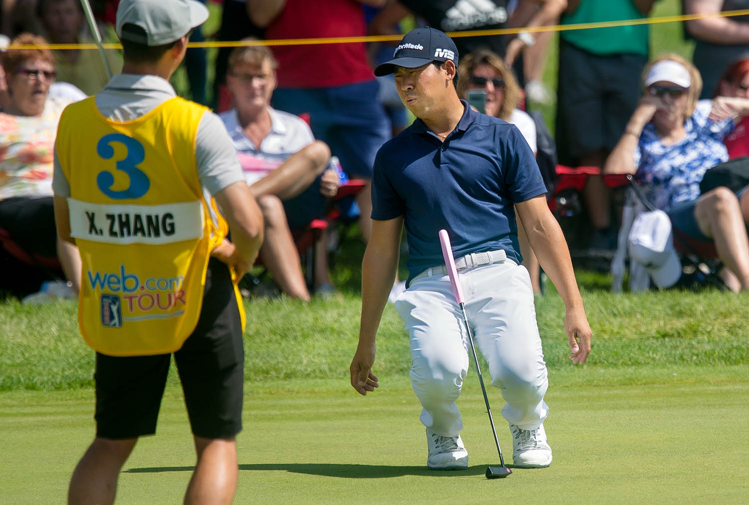 Xinjun Zhang's knees buckle after his missed a putt on the second playoff hole against Dylan Wu during the fourth round of Web.com Tour's Lincoln Land Championship presented by LRS Sunday, June 16, 2019. Zhang and Wu tied on the hole before Zhang won on the third playoff hole. [Ted Schurter/The State Journal-Register]