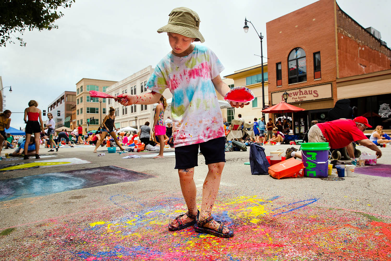 Six-year-old Eddie Longcore drips paint onto his creation during the Springfield Art Association's 2019 Paint the Street event in downtown Springfield, Ill., Saturday, June 22, 2019. Participants and groups were given a 6' x 6' square upon which they could create their own design. Proceeds from the event help fund the association's operations and programming. [Ted Schurter/The State Journal-Register]