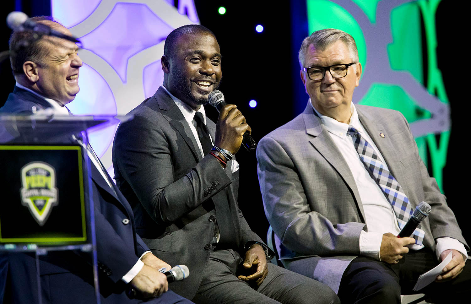 Former St. Louis Ram and Pro Football Hall of Famer Marshall Faulk laughs with Paul Wappel, left, and Jim Ruppert during the annual Best of Capital Region Preps Awards at the Bank of Springfield Center Thursday, June 27, 2019. [Ted Schurter/The State Journal-Register]