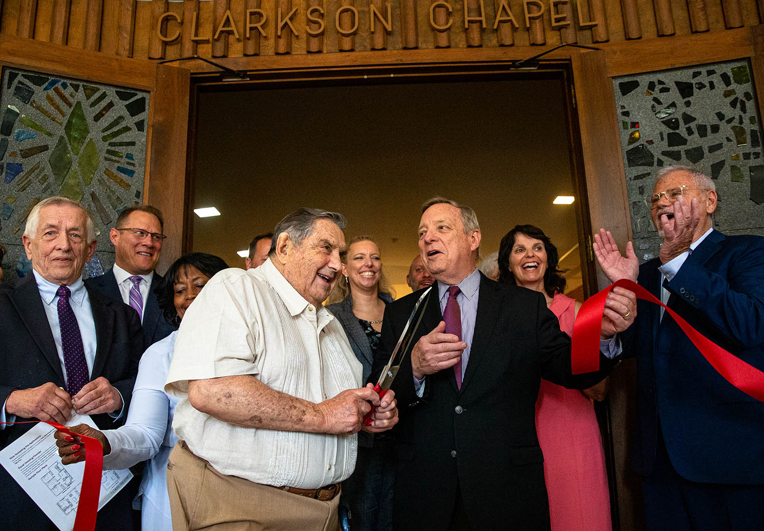 Irv Smith, center, cuts the ribbon along with U.S. Sen. Dick Durbin, D-Ill., outside the Clarkson Chapel in the former First United Methodist Church as the Economic Growth Corporation celebrates the opening of the former church as the Centre @ 501 residential and commercial building, Friday, June 28, 2019, in Springfield, Ill. The Economic Growth Corporation credited Irv Smith, the former property owner, for giving a substantial discount on the sale of the property as major factor in the success of the project.  [Justin L. Fowler/The State Journal-Register]