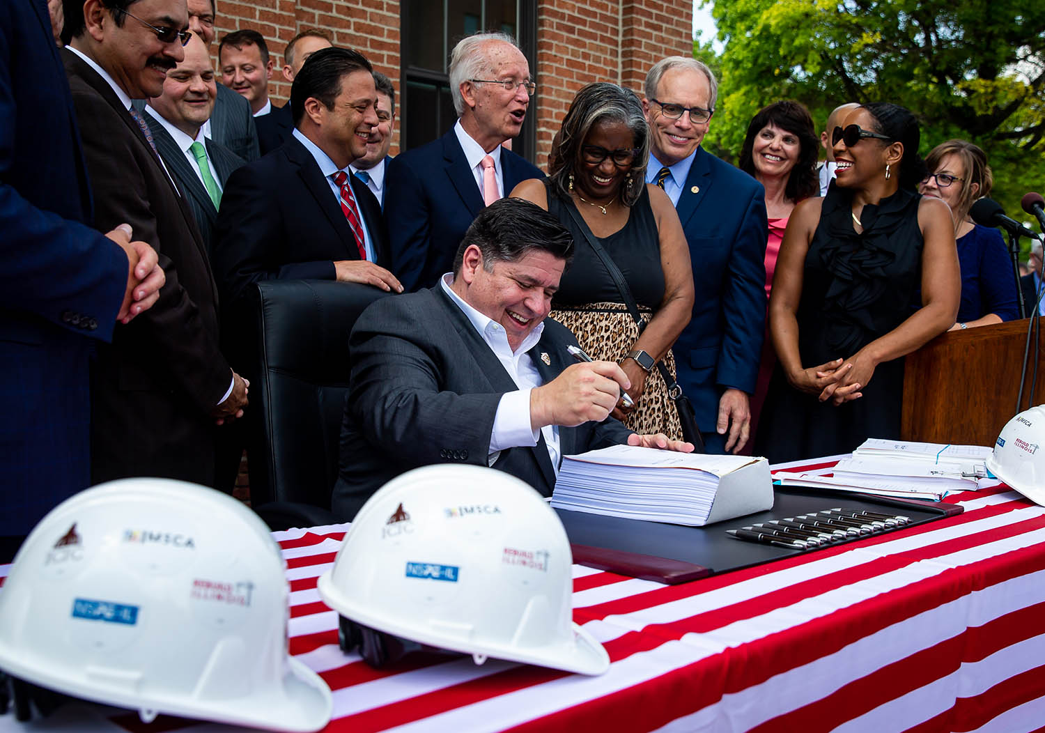 Illinois Gov. J.B. Pritzker signs into law a massive expansion of gambling in Illinois and a $45 billion construction and infrastructure plan during a ceremony outside the Lincoln Depot, Friday, June 28, 2019, in Springfield, Ill. The capital plan includes $122 million to complete work on relocating train traffic in Springfield away from the Third Street corridor and onto 10th Street. [Justin L. Fowler/The State Journal-Register]