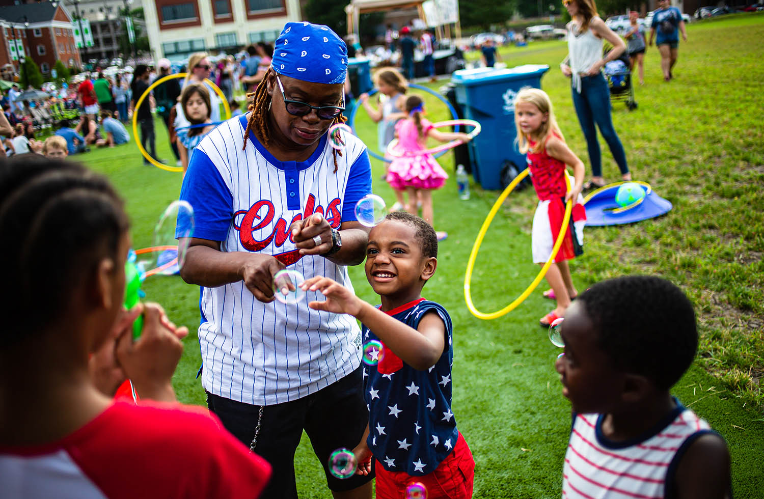 Levi Allan, 5, plays with a bubble machine with his grandmother, Leslie Favors, in the children's area during the Levitt AMP Springfield Music Series on the Y-Block , Thursday, July 4, 2019, in Springfield, Ill. [Justin L. Fowler/The State Journal-Register]