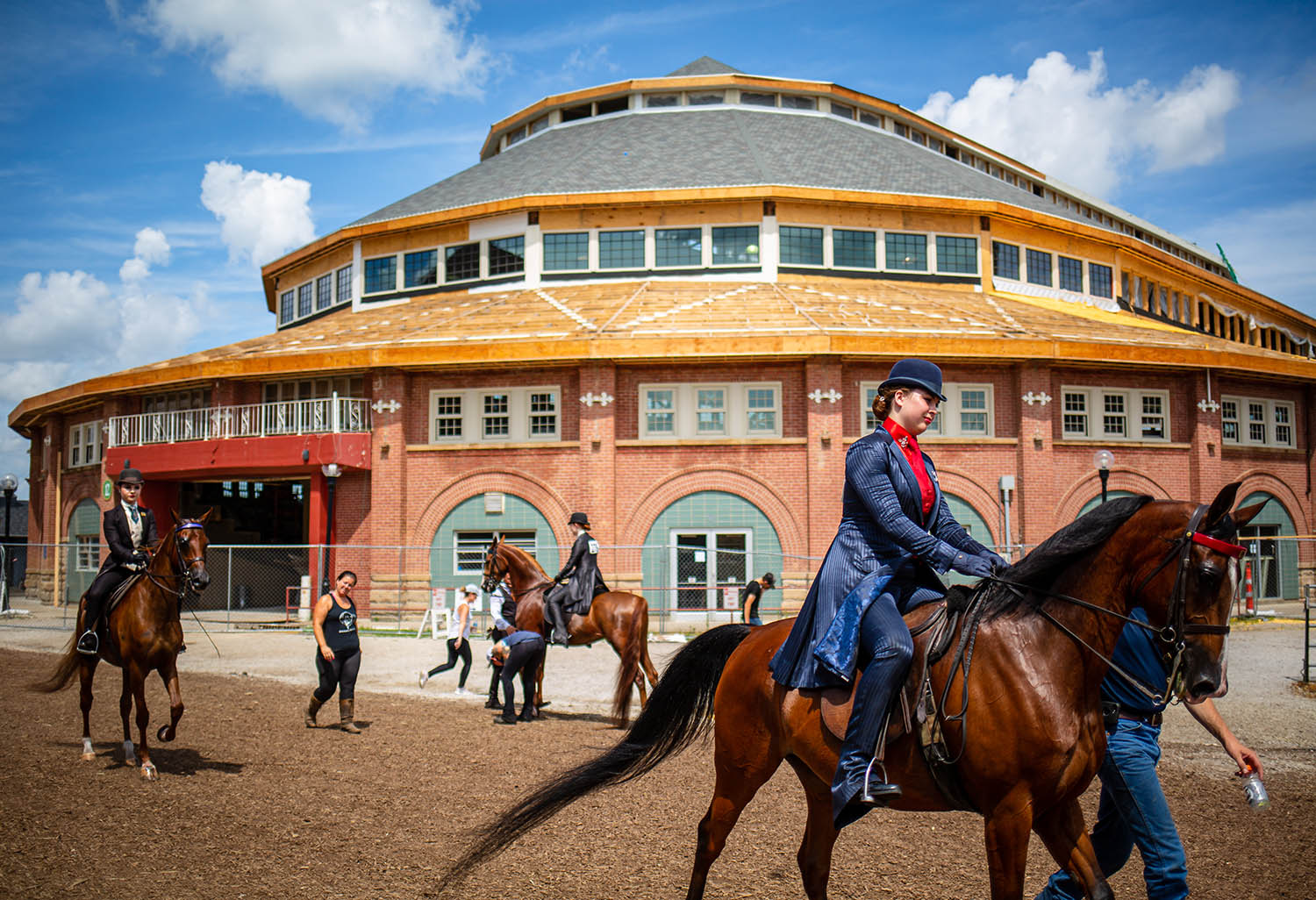Taylor Richman, atop half-Arabian Southern Connection, heads to the Enclosed Arena to show as the rehabilitation of the Coliseum continues during the Arabian Horse Association's Region 11 Championships at the Illinois State Fairgrounds, Saturday, July 6, 2019, in Springfield, Ill. [Justin L. Fowler/The State Journal-Register]
