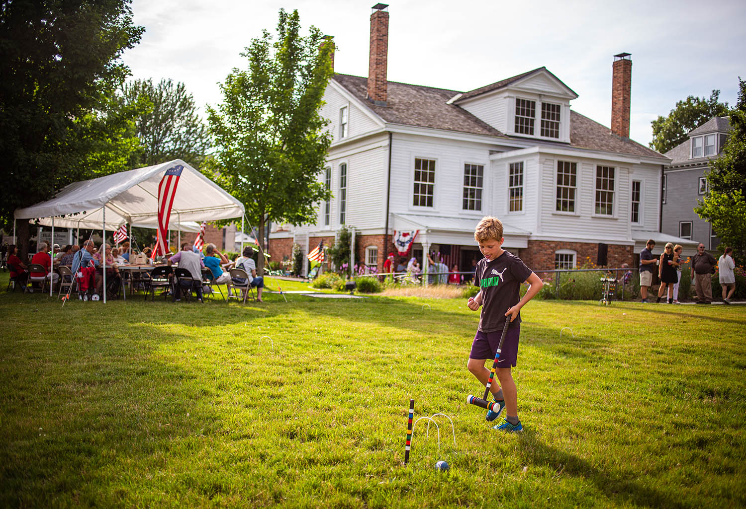 "Nathan Frey, 9, reacts as his croquet ball hits the center peg while playing in the newly enlarged backyard area during the annual ""Clara Irwin's Strawberry Party"" at theElijah Iles House, Thursday, July 4, 2019, in Springfield, Ill. The annual event celebrates Clara Irwin, who was the spouse of the second owner of the Elijah Iles House, and was known for her advocacy of the horticultural arts and also for her strawberries and strawberry parties in the 1840s and '50s. [Justin L. Fowler/The State Journal-Register]"