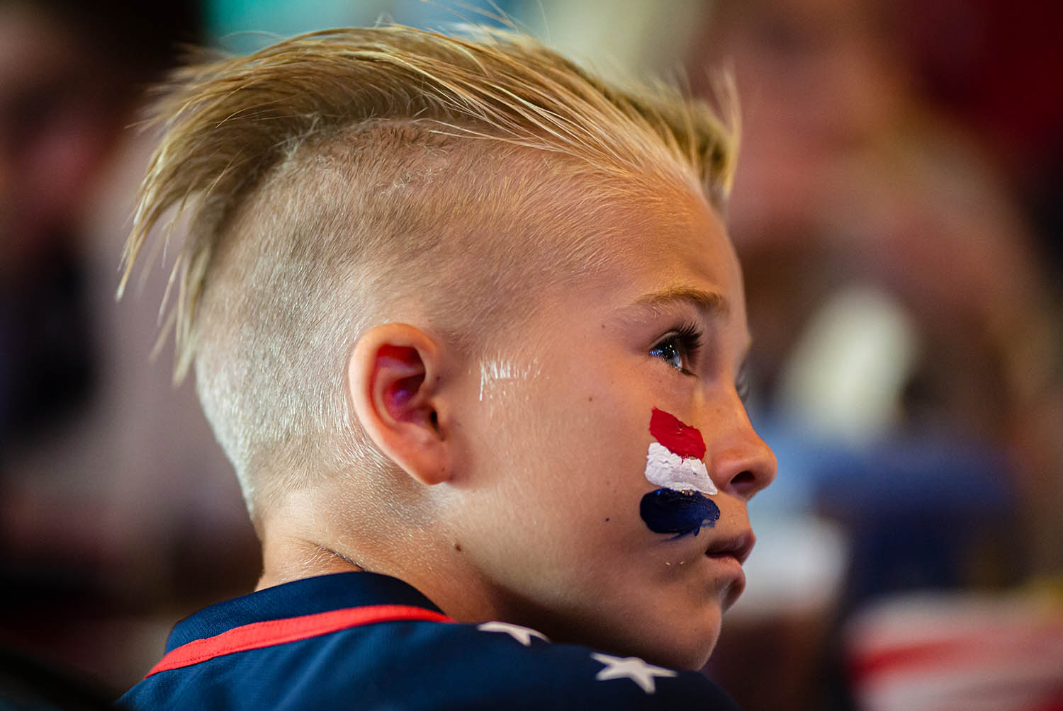 Cole Woodward, 9, of Chatham, Ill., watches the United States take on the Netherlands in the Women's World Cup final during a watch party hosted by the American Outlaws Land of Lincoln chapter at The Alamo, Sunday, July 7, 2019, in Springfield, Ill. [Justin L. Fowler/The State Journal-Register]