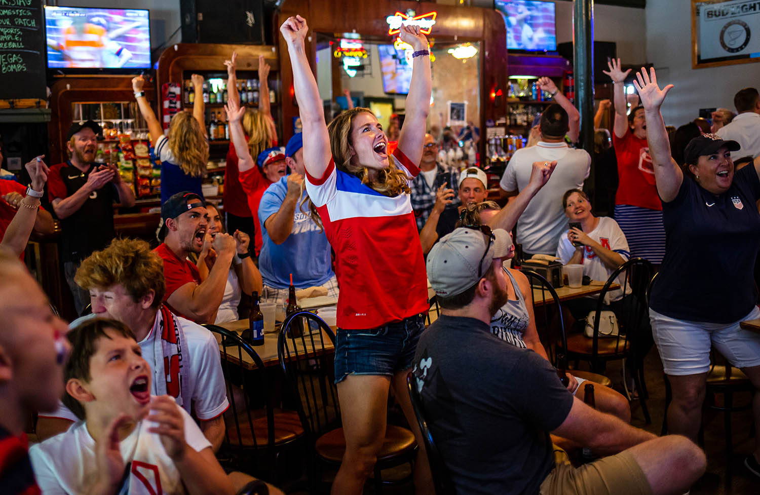 "Missy Gee, center, celebrates a penalty kick goal by United States' Megan Rapinoe to put the USA up 1-0 over the Netherlands in the Women's World Cut final during a watch party hosted by the American Outlaws Land of Lincoln chapter at The Alamo, Sunday, July 7, 2019, in Springfield, Ill. ""It's awesome, It's so inspiring to see these women out here and do so great and inspiring a nation,"" said Gee who played soccer at Springfield High School and Eastern Illinois University. [Justin L. Fowler/The State Journal-Register]"