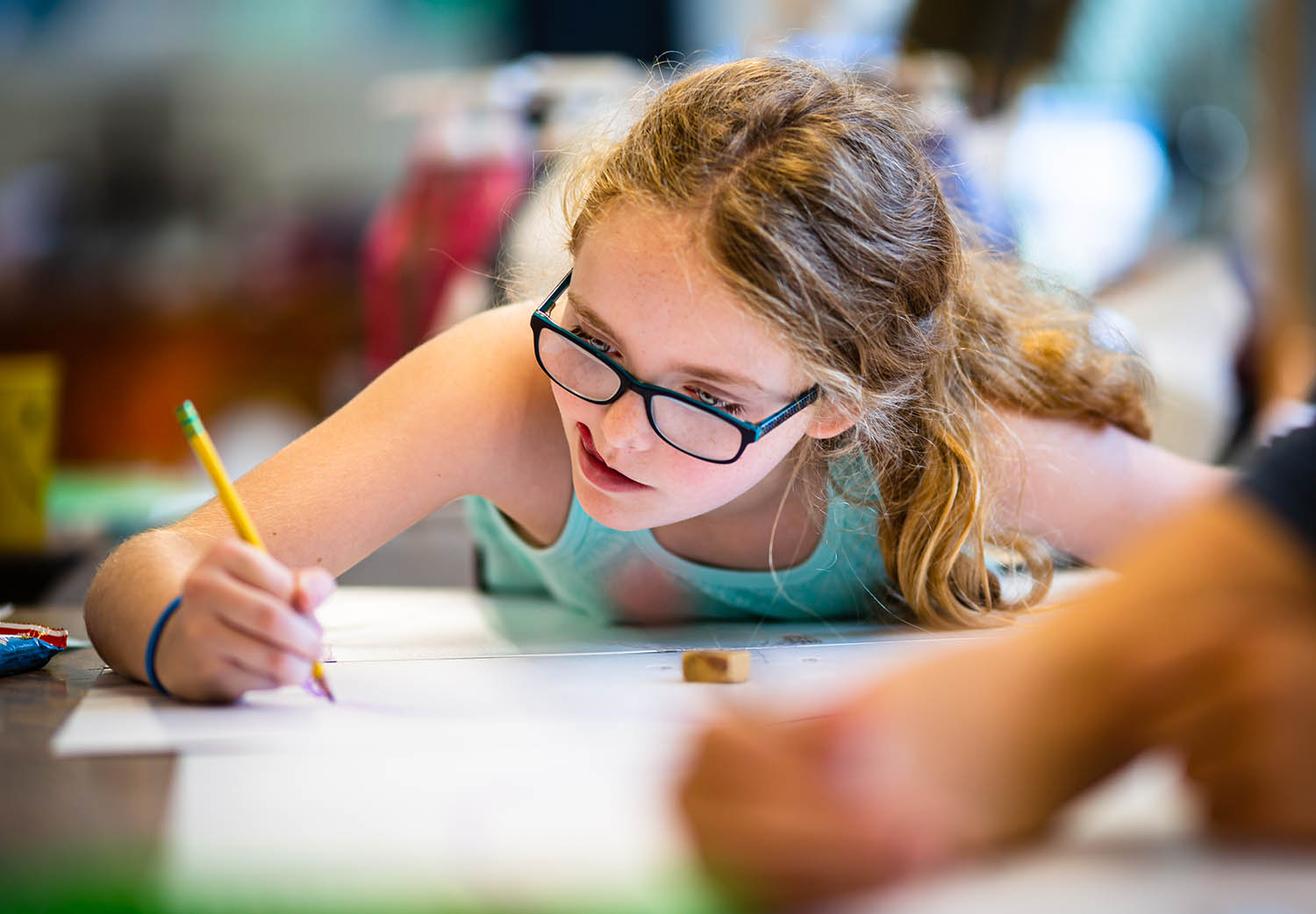 "Esme Eck, 11, reproduces a drawing of an ""Exquisite Corpse"" on a thin piece of styrofoam that will be used to make a print out of an impression from the drawing during the Summer Art Camp for Large-Scale Printmaking at the Springfield Art Association main campus, Thursday, July 11, 2019, in Springfield, Ill. The ""Exquisite Corpse"" method is drawing an image of a person in which one artist draws the head, then the next artist draws the torso and the next draws the legs, with each of them unable to see what the previous artist had drawn. [Justin L. Fowler/The State Journal-Register]"