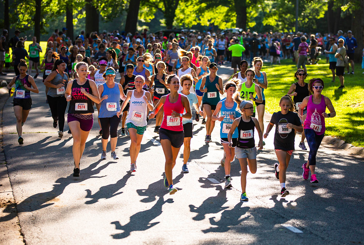 Women of all ages cascade down the road as they start the 2 mile run in the 40th annual Women's Distance Festival in Washington Park, Saturday, July 13, 2019, in Springfield, Ill. In July of 1980 the Road Runners Club of America launched the Women's Distance Festival in protest that women were not included in the distance running events for the 1980 Olympics in Moscow. The Women's Distance Festival races are held across the country and celebrate the history of women's rights to participate in running events at any distance and at any age. [Justin L. Fowler/The State Journal-Register]