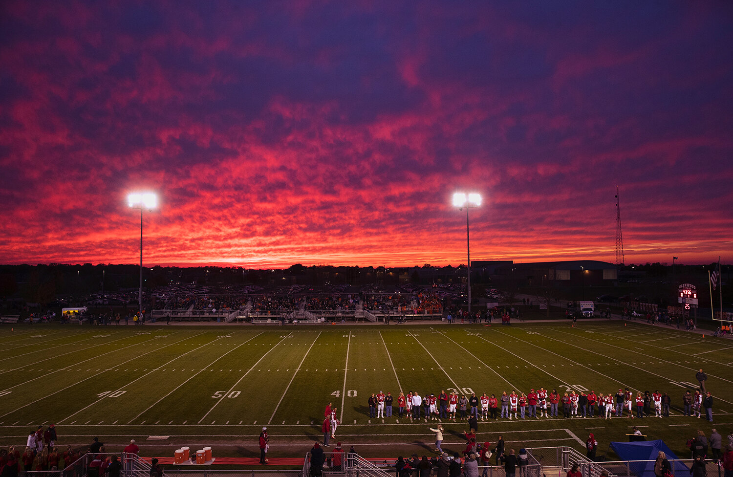 Glenwood seniors line up in front of a colorful sunset for Senior Night recognition before facing off against Rochester at Glenwood High School Friday, Oct. 25, 2019.  [Ted Schurter/The State Journal-Register]