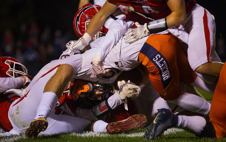 Titan defenders bring down Rochester's Jordan Raps (9) at Glenwood High School Friday, Oct. 25, 2019. [Ted Schurter/The State Journal-Register]