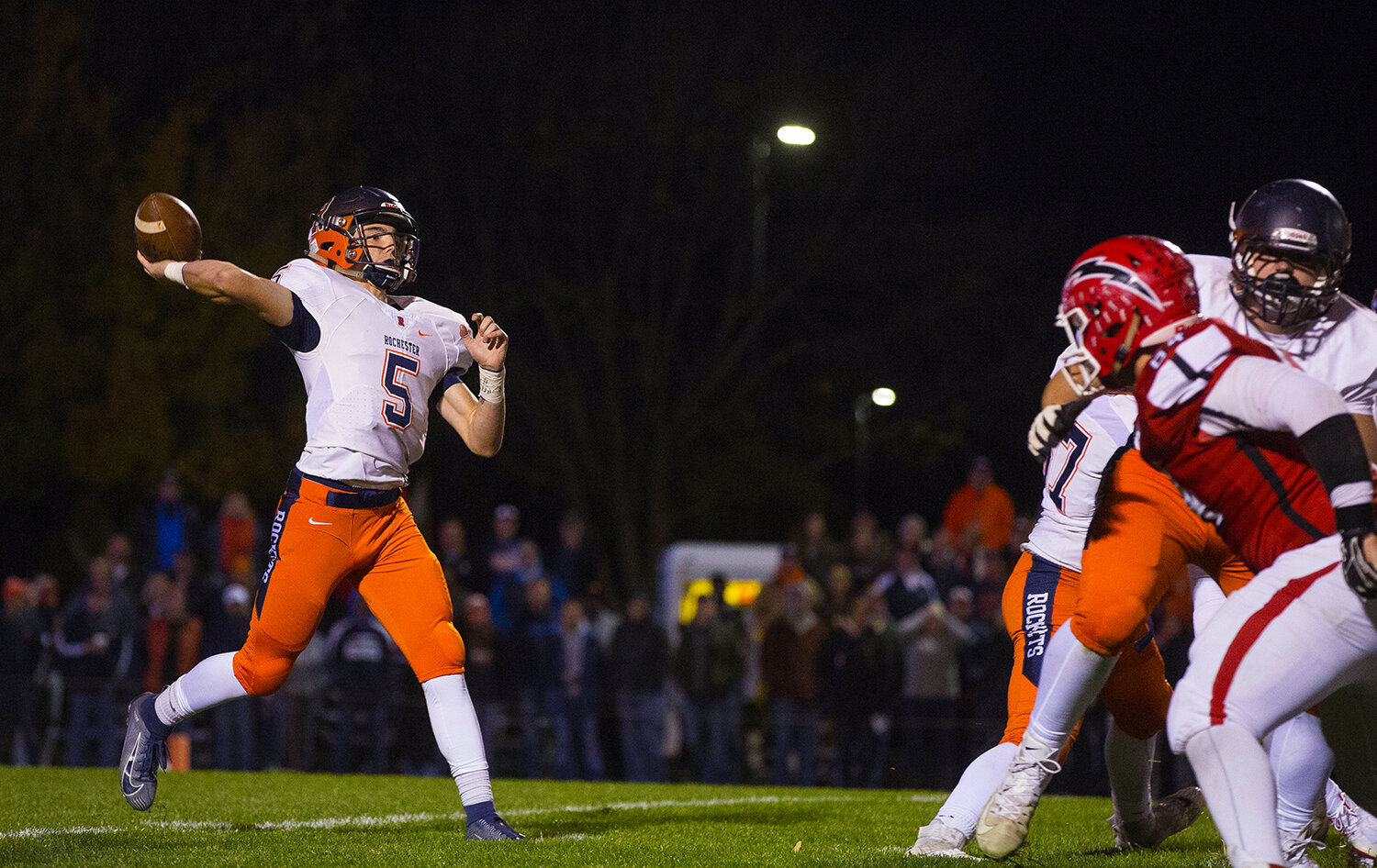 Rochester quarterback Clay Bruno (5)  fires a pass downfield at Glenwood High School Friday, Oct. 25, 2019. [Ted Schurter/The State Journal-Register]