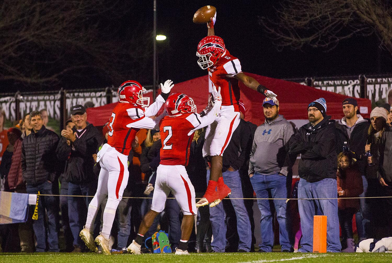 Glenwood's Narkel LeFlore (6)  celebrates a first half touchdown against Rochester at Glenwood High School Friday, Oct. 25, 2019. [Ted Schurter/The State Journal-Register]