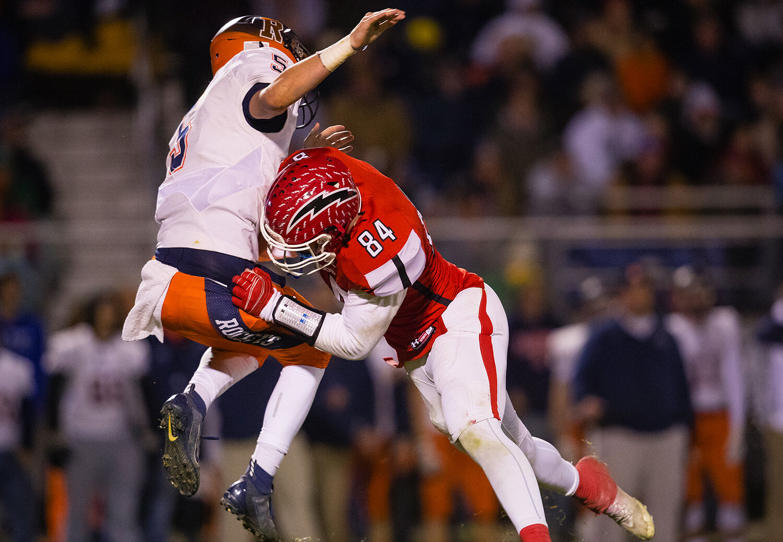 Glenwood's Eli Vogler (84) crashes into Rochester quarterback Clay Bruno (5) after he released a pass against Glenwood at Glenwood High School Friday, Oct. 25, 2019. [Ted Schurter/The State Journal-Register]