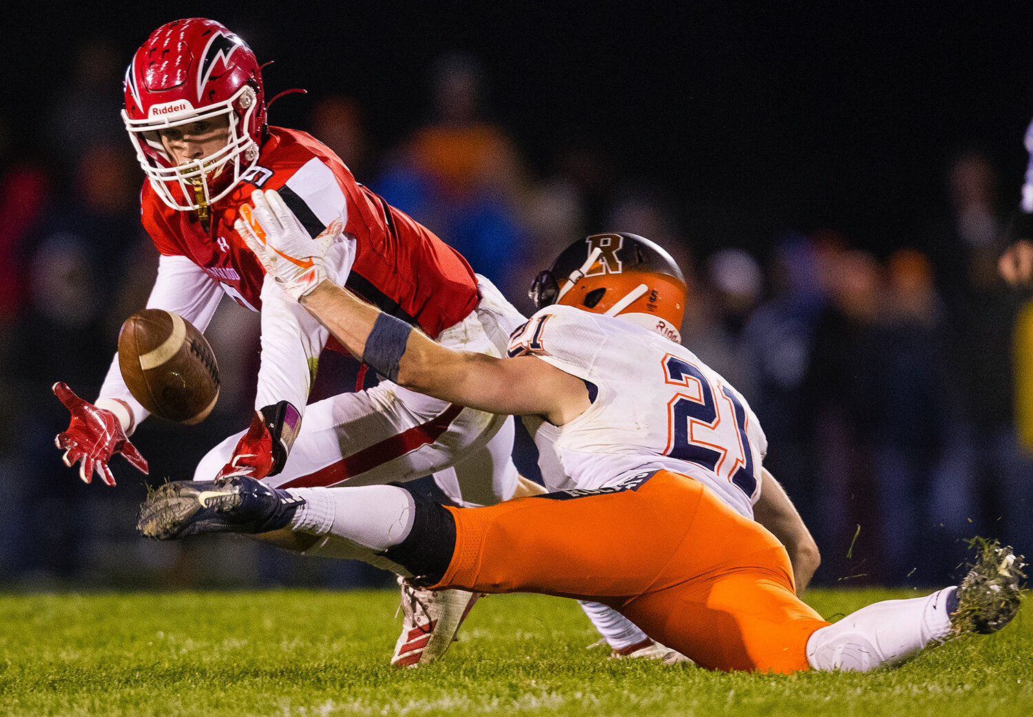 Glenwood's Ian Benner (9)  lunges for a pass intended for Rochester's David Yoggerst (21) at Glenwood High School Friday, Oct. 25, 2019. [Ted Schurter/The State Journal-Register]