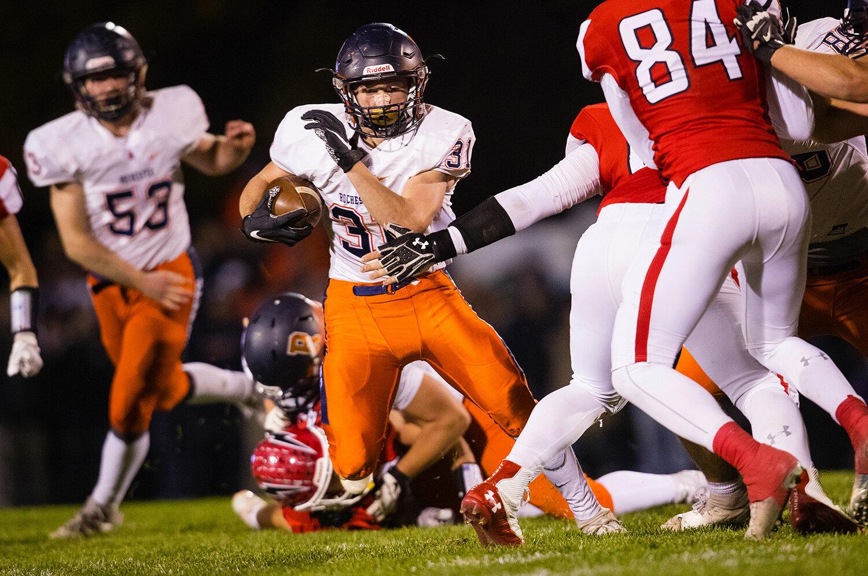 Rochester's Jacob DuRocher (31)  runs the ball against Glenwood at Glenwood High School Friday, Oct. 25, 2019. [Ted Schurter/The State Journal-Register]