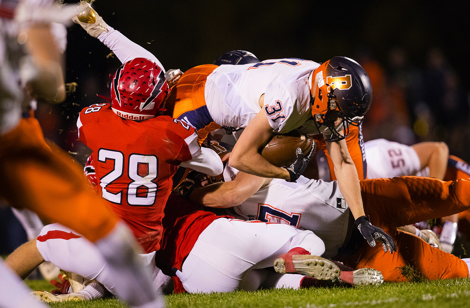 Rochester's Jacob DuRocher (31)  is wrapped up by Glenwood's Austin Bush (28) at Glenwood High School Friday, Oct. 25, 2019. [Ted Schurter/The State Journal-Register]