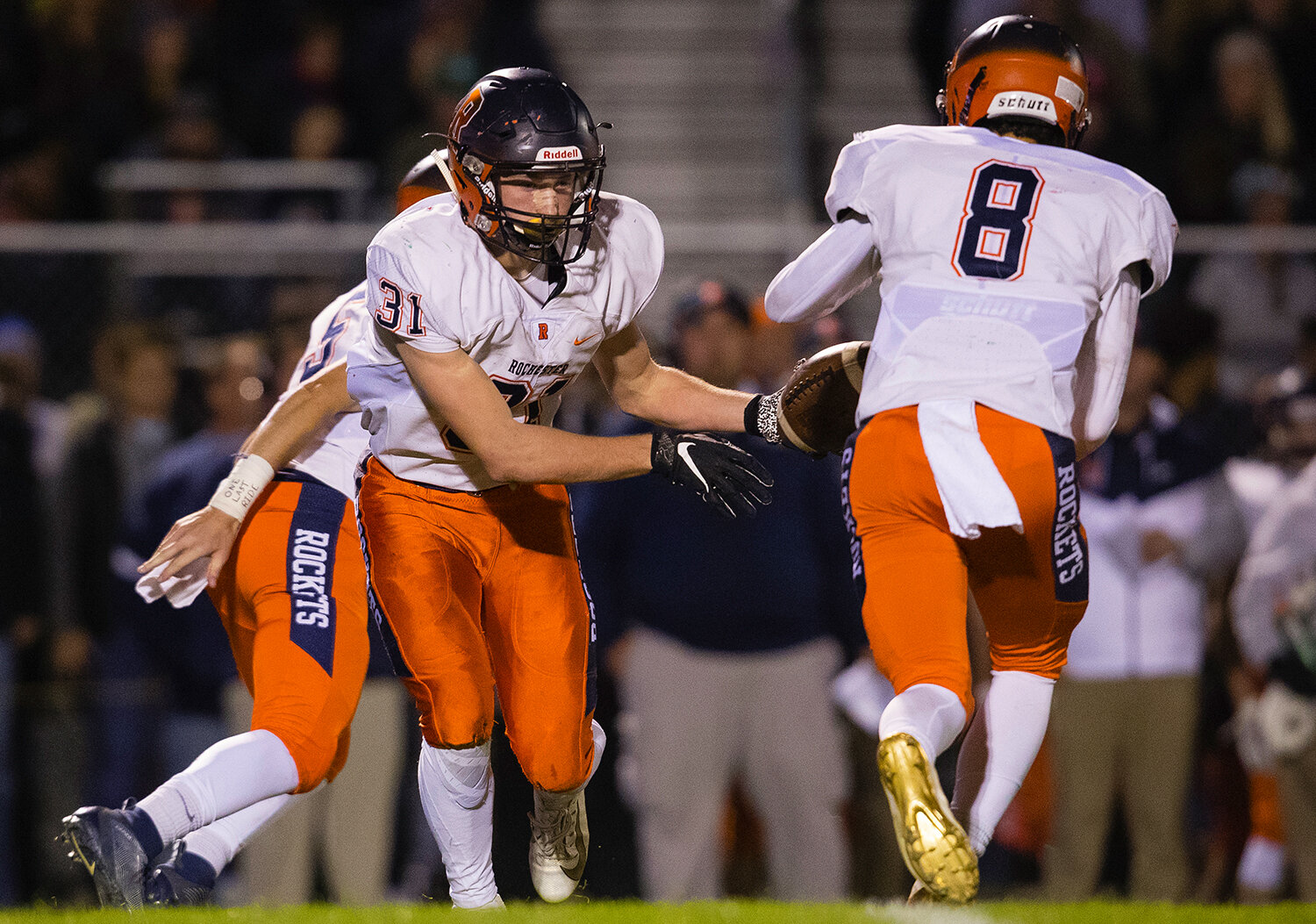 Rochester's Jacob DuRocher (31)  hands off to Rochester's Hank Beatty (8)  at Glenwood High School Friday, Oct. 25, 2019. [Ted Schurter/The State Journal-Register]