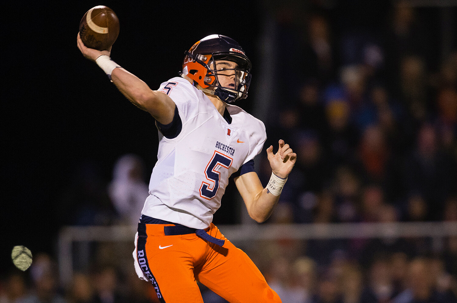 Rochester quarterback Clay Bruno (5)  throws downfield at Glenwood High School Friday, Oct. 25, 2019. [Ted Schurter/The State Journal-Register]