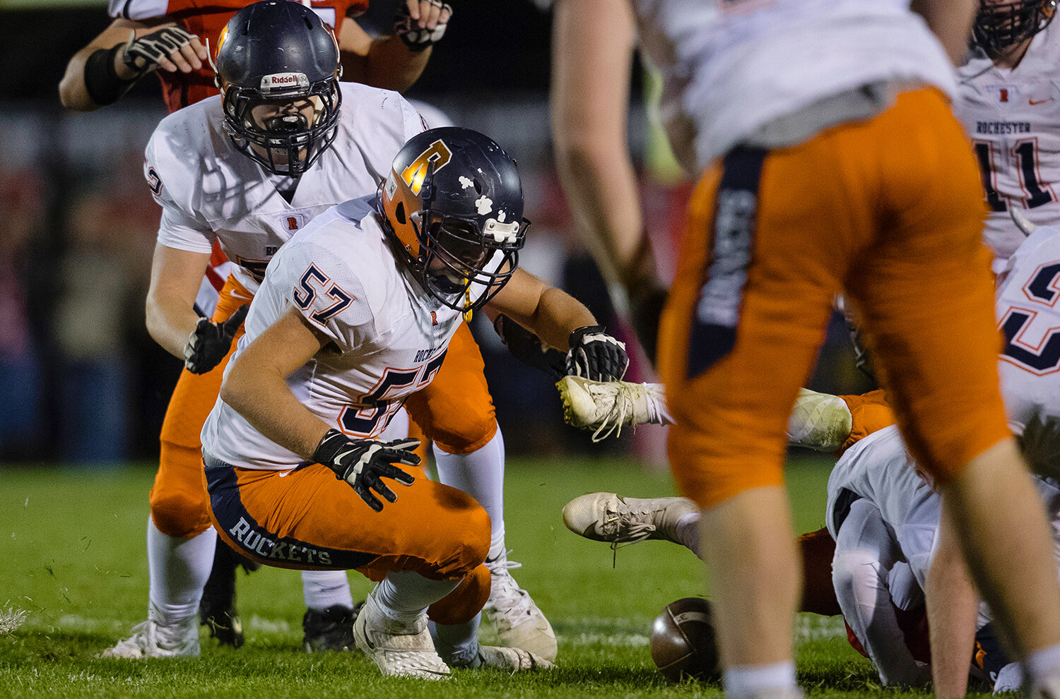 Rochester's Josh Scranton (57)  scrambles for a fumbled ball at Glenwood High School Friday, Oct. 25, 2019. [Ted Schurter/The State Journal-Register]