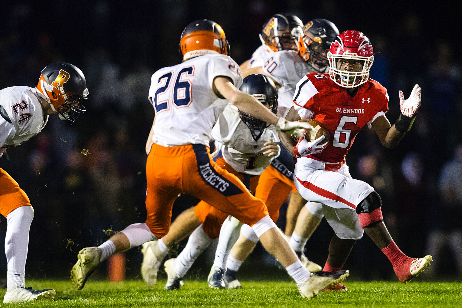 Glenwood's Narkel LeFlore (6) sprints ahead of a pack of Rochester defenders at Glenwood High School Friday, Oct. 25, 2019. [Ted Schurter/The State Journal-Register]