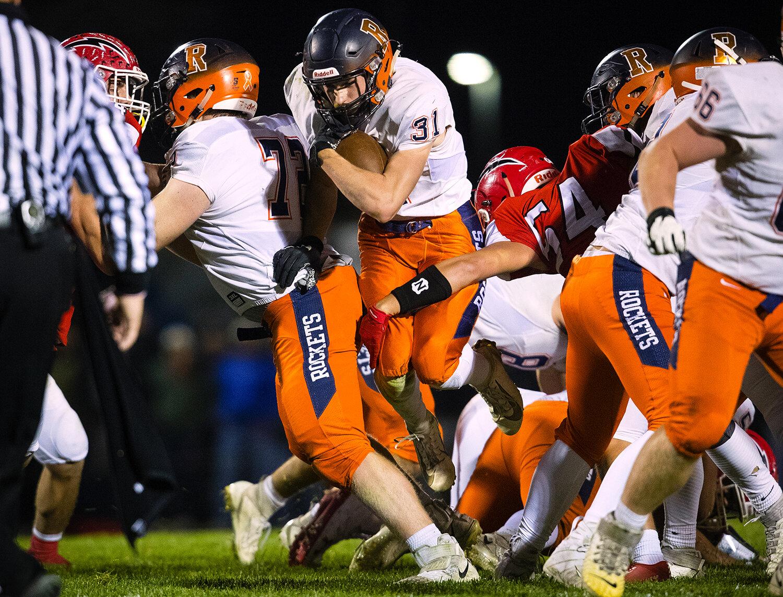 Rochester's Jacob DuRocher (31) breaks through the line against Glenwood  at Glenwood High School Friday, Oct. 25, 2019. [Ted Schurter/The State Journal-Register]