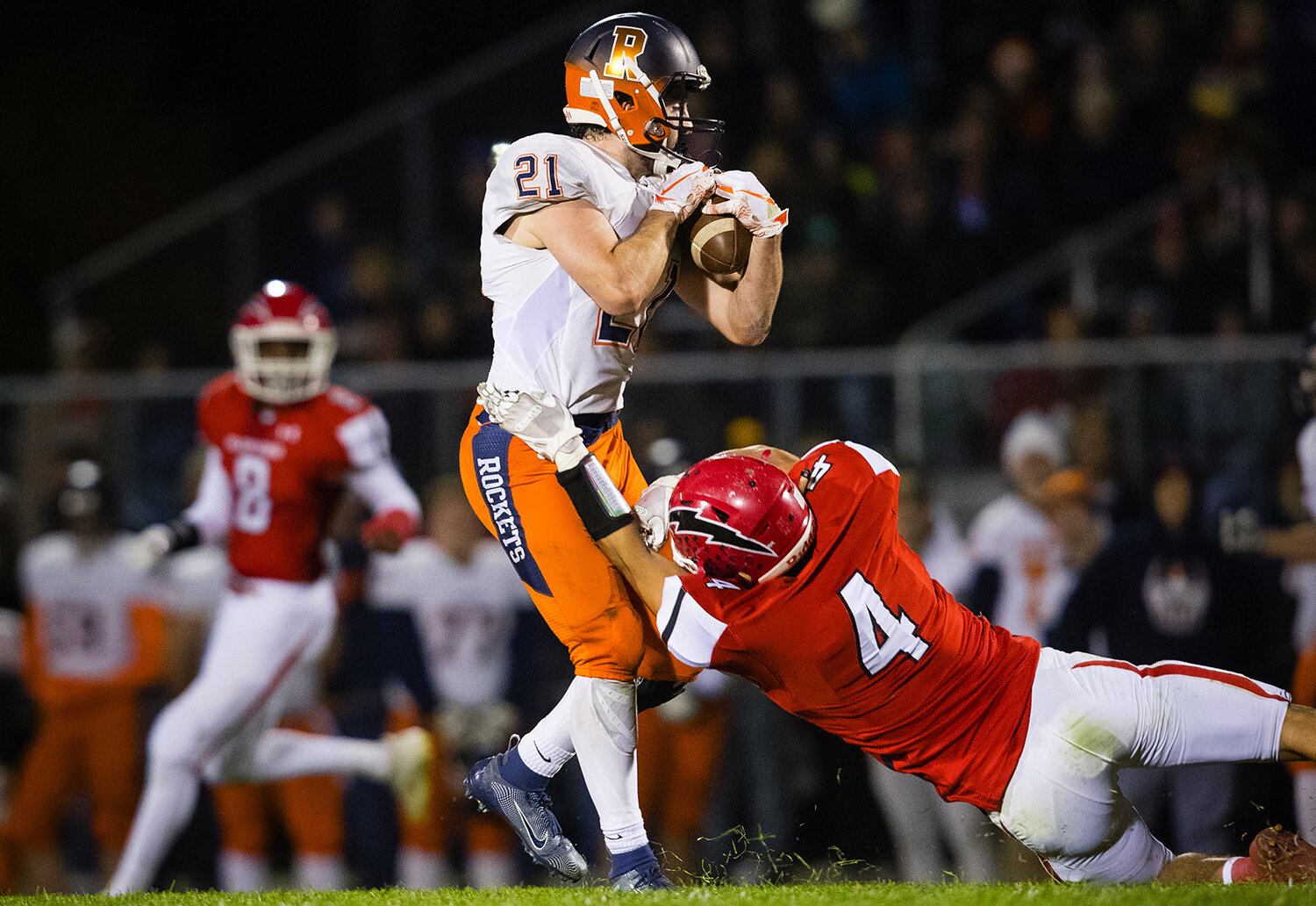 Rochester's David Yoggerst (21)  makes a catch in front of Glenwood's Jake Burris (4)  at Glenwood High School Friday, Oct. 25, 2019. [Ted Schurter/The State Journal-Register]