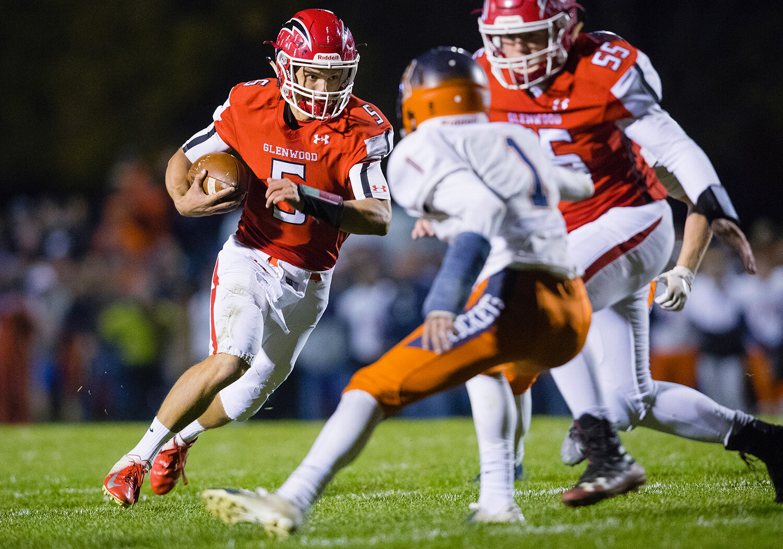 Glenwood quarterback Luke Lehnen (5)  looks for an opening as he rushes against Rochester at Glenwood High School Friday, Oct. 25, 2019. [Ted Schurter/The State Journal-Register]