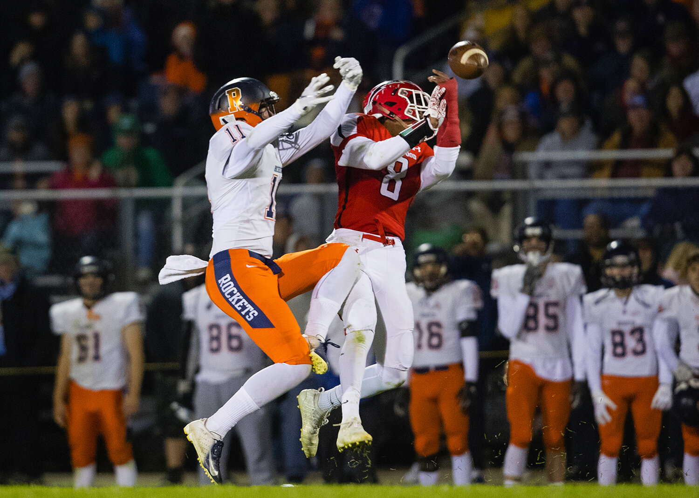Rochester's Jack Friedewald (11)  pressures Glenwood's Caleb Walker (8) on a pass attempt at Glenwood High School Friday, Oct. 25, 2019. [Ted Schurter/The State Journal-Register]