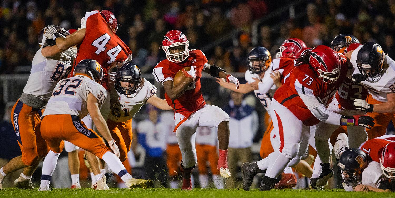 Glenwood's Narkel LeFlore (6) runs through a gap in the line at Glenwood High School Friday, Oct. 25, 2019. [Ted Schurter/The State Journal-Register]