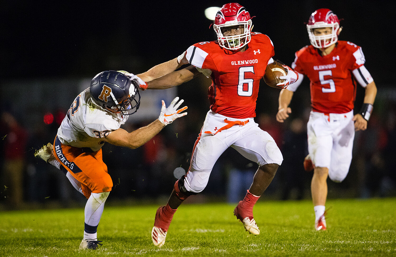 Glenwood's Narkel LeFlore (6) stiff arms a Rochester defender at Glenwood High School Friday, Oct. 25, 2019. [Ted Schurter/The State Journal-Register]