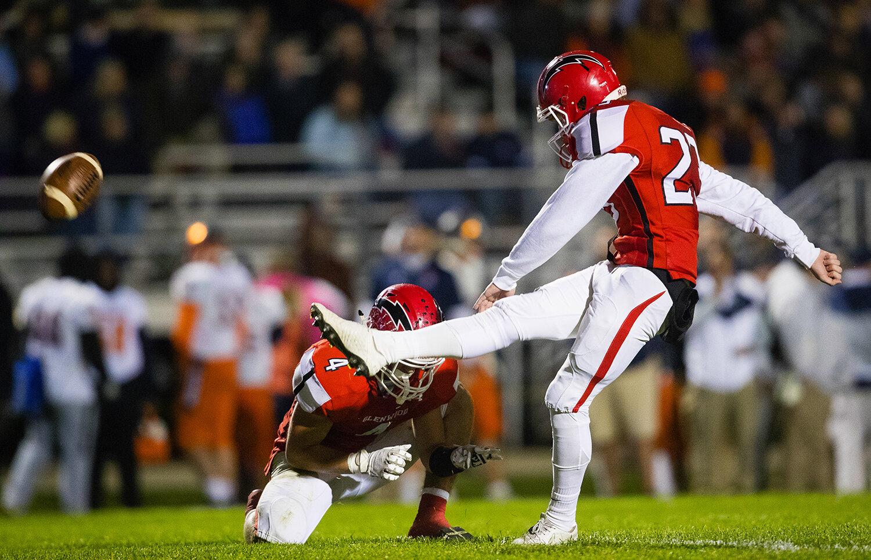 Glenwood's Alek Votava (23)  boots an extra point at Glenwood High School Friday, Oct. 25, 2019. [Ted Schurter/The State Journal-Register]