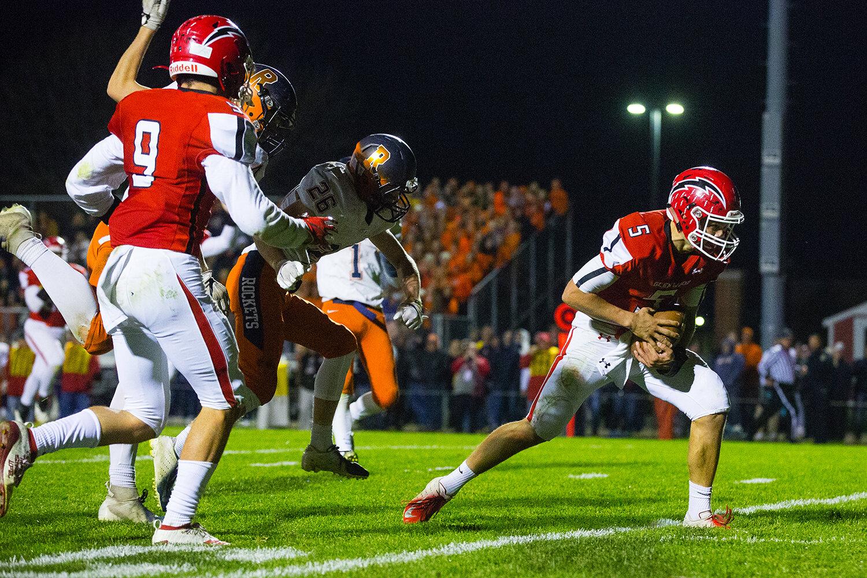 Glenwood quarterback Luke Lehnen (5) scores a touchdown against Rochester at Glenwood High School Friday, Oct. 25, 2019. [Ted Schurter/The State Journal-Register]