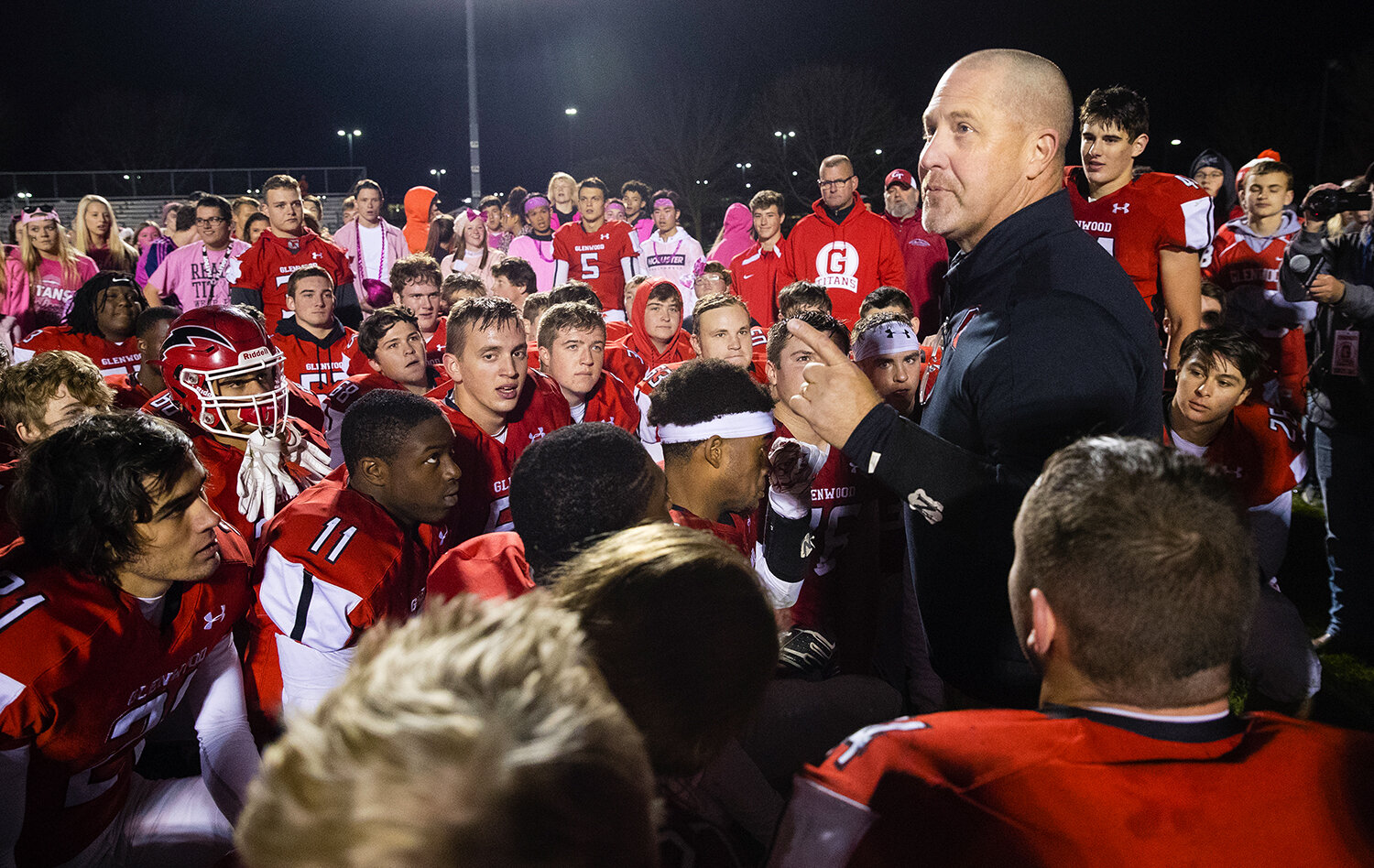 Glenwood football head coach David Hay congratulates the Titans for winning the CS8 title outright after a victory against Rochester at Glenwood High School Friday, Oct. 25, 2019. [Ted Schurter/The State Journal-Register]