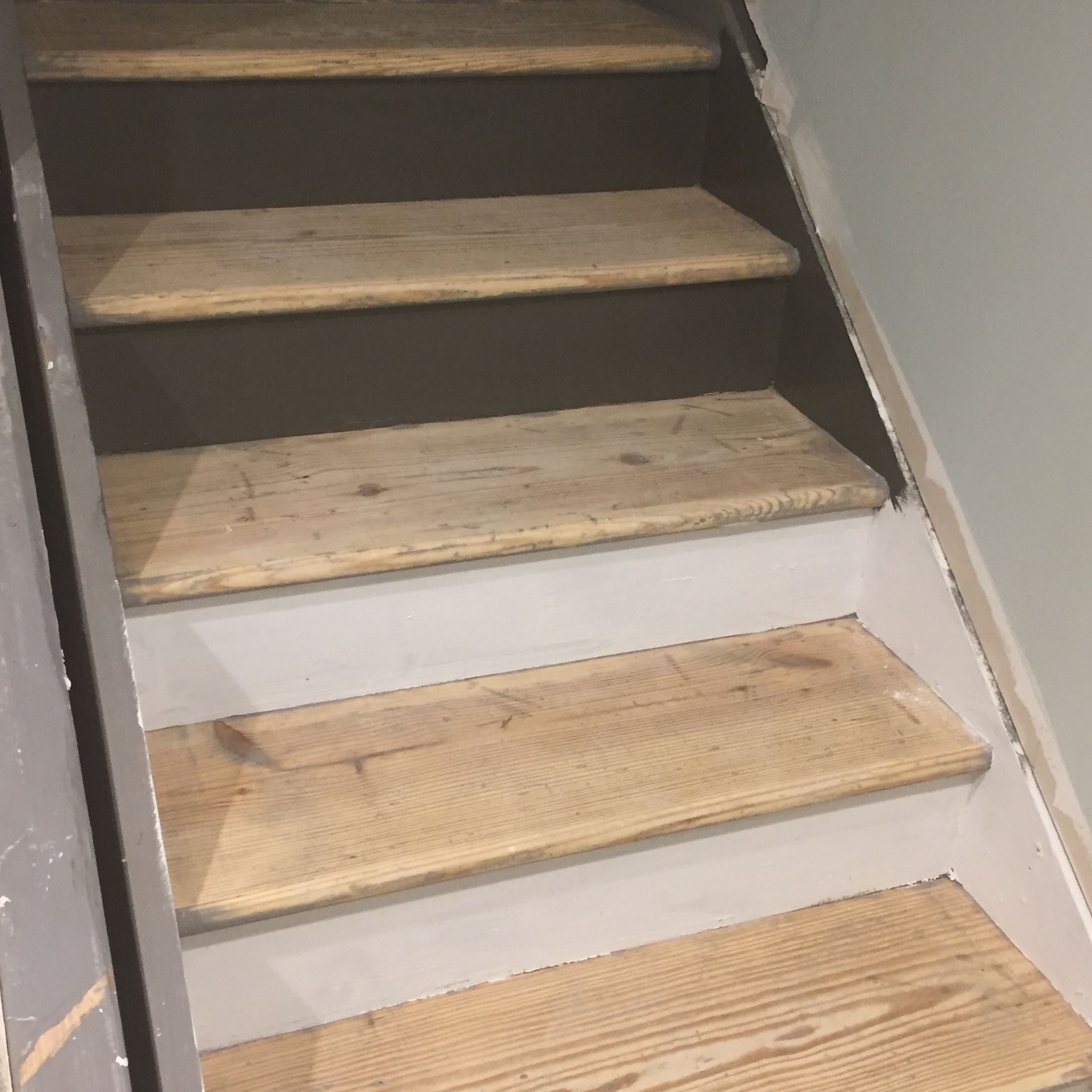 We debated Painting the Stair Risers white or Urbane Bronze