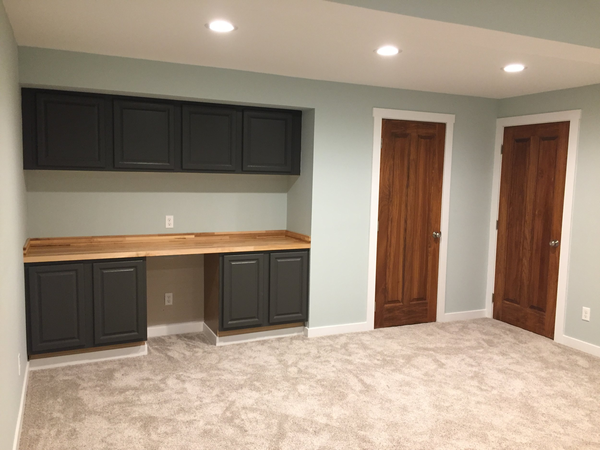 Urbane Bronze Cabinets, Maple Butcher Block, and Sea Glass Walls - Finished Basement