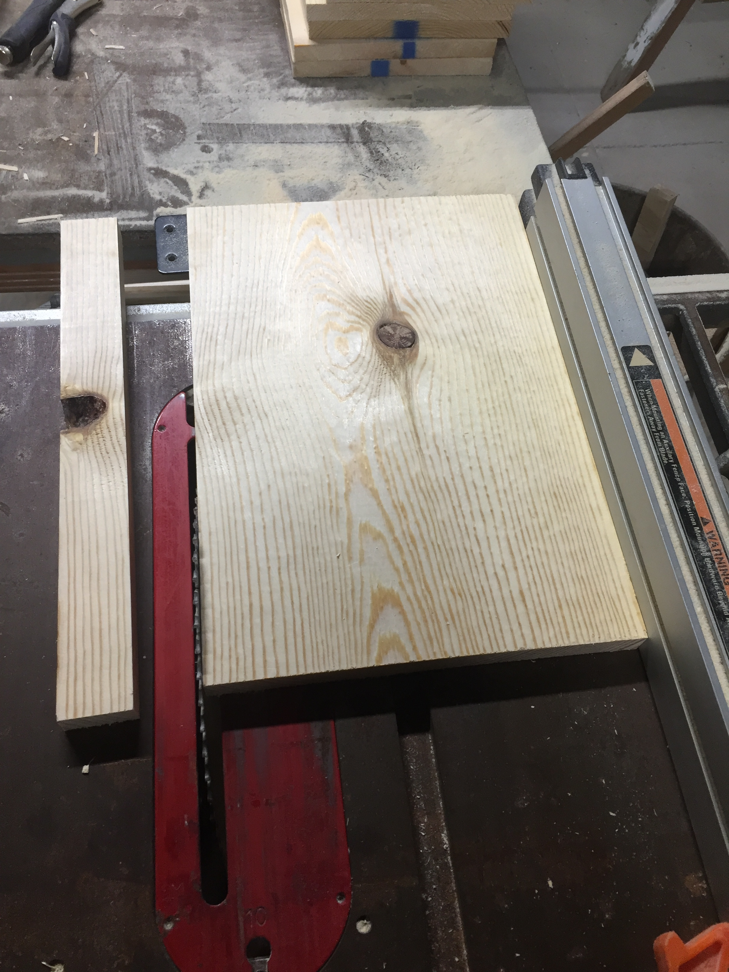 Ripping the boards to width and removing knots and other imperfections.