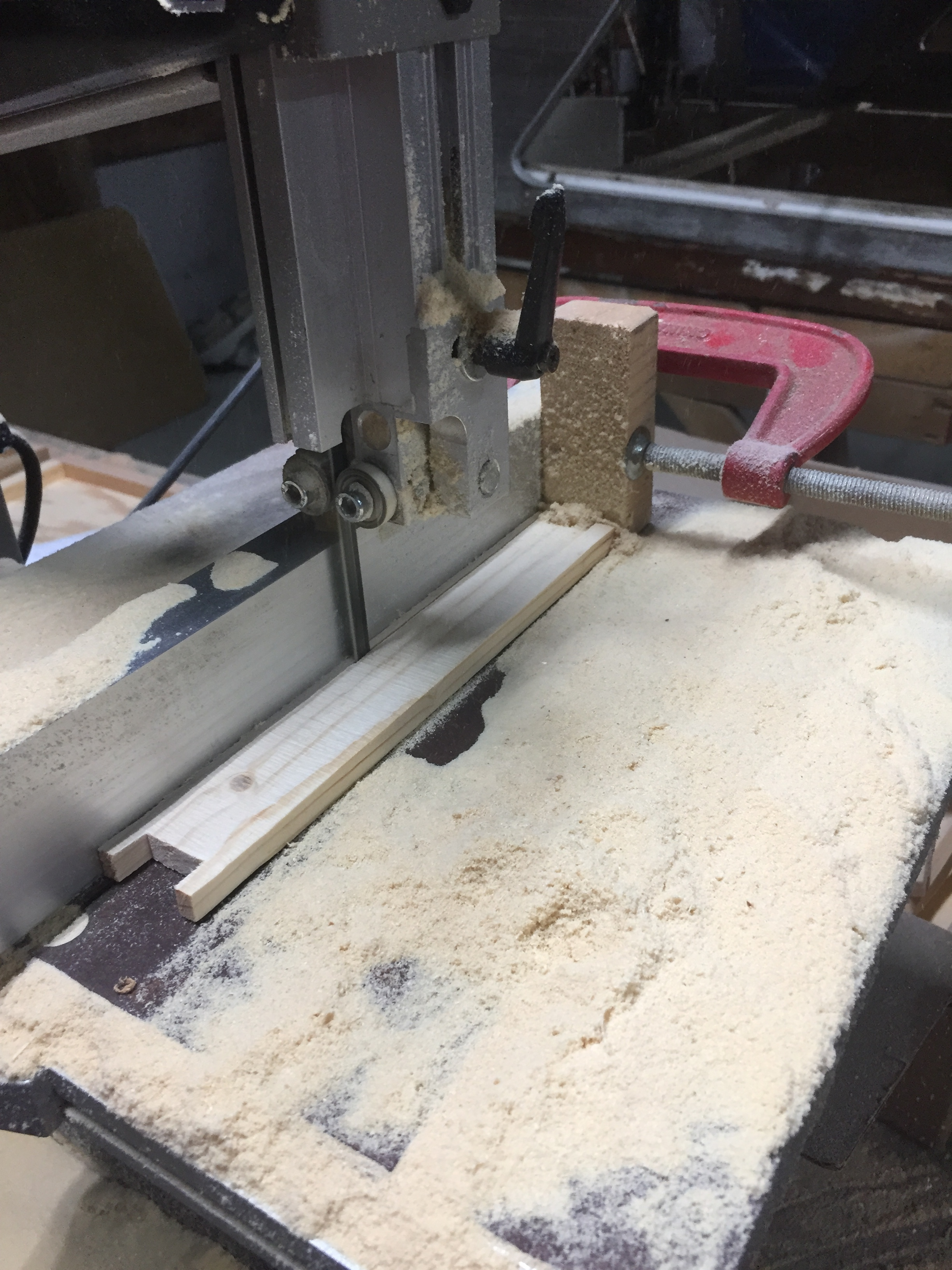 Cutting the frame side profile. Use a stop block for consistent cuts.