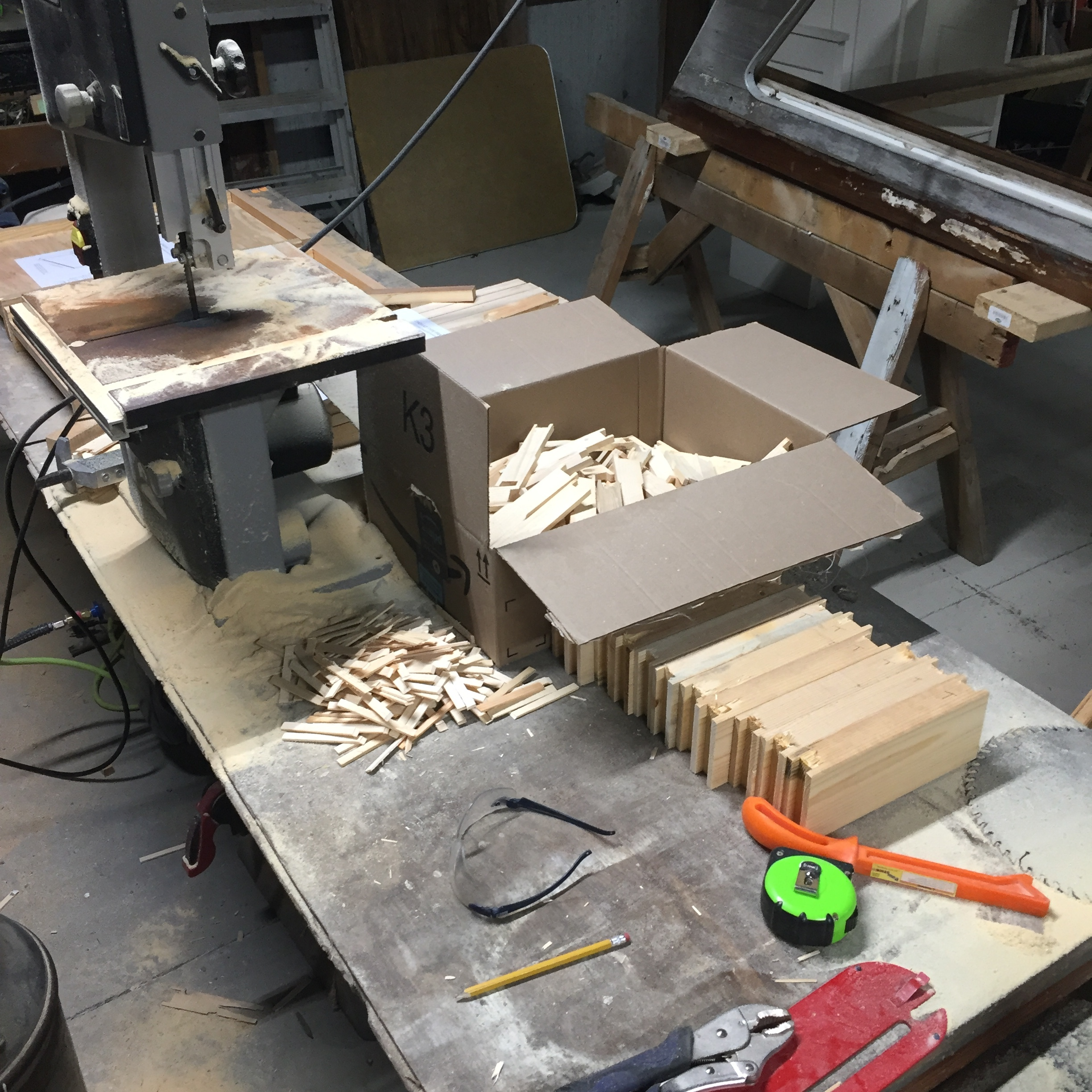 Cutting bee frames from 2x4 blocks on the band saw.