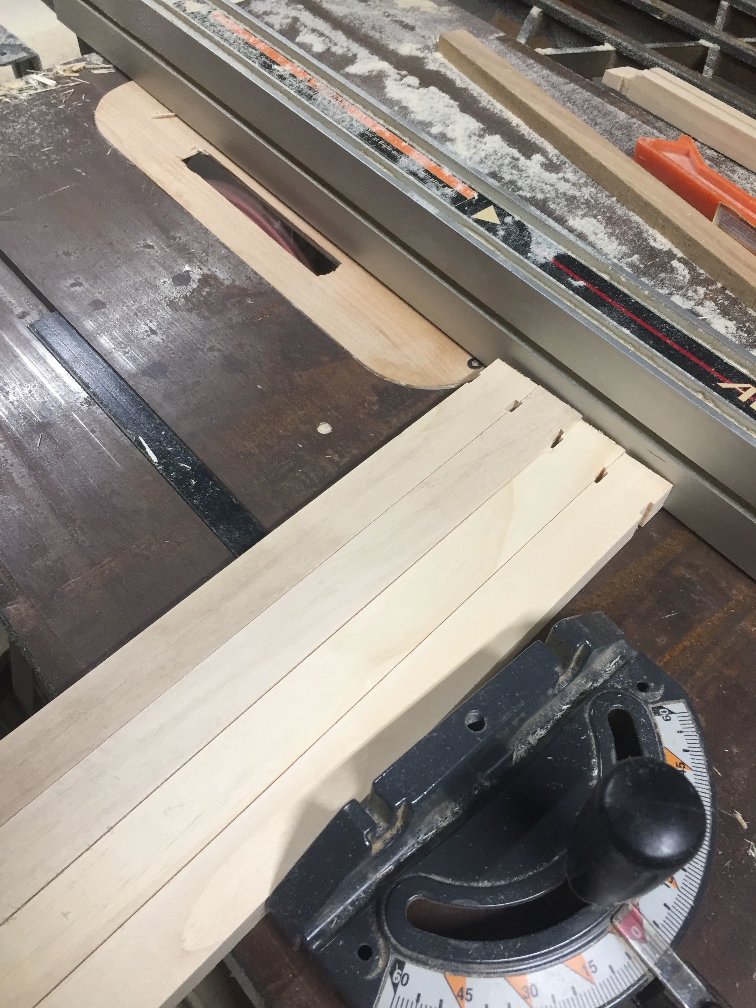 Cutting the deeper groove on the bottom of the top bar.