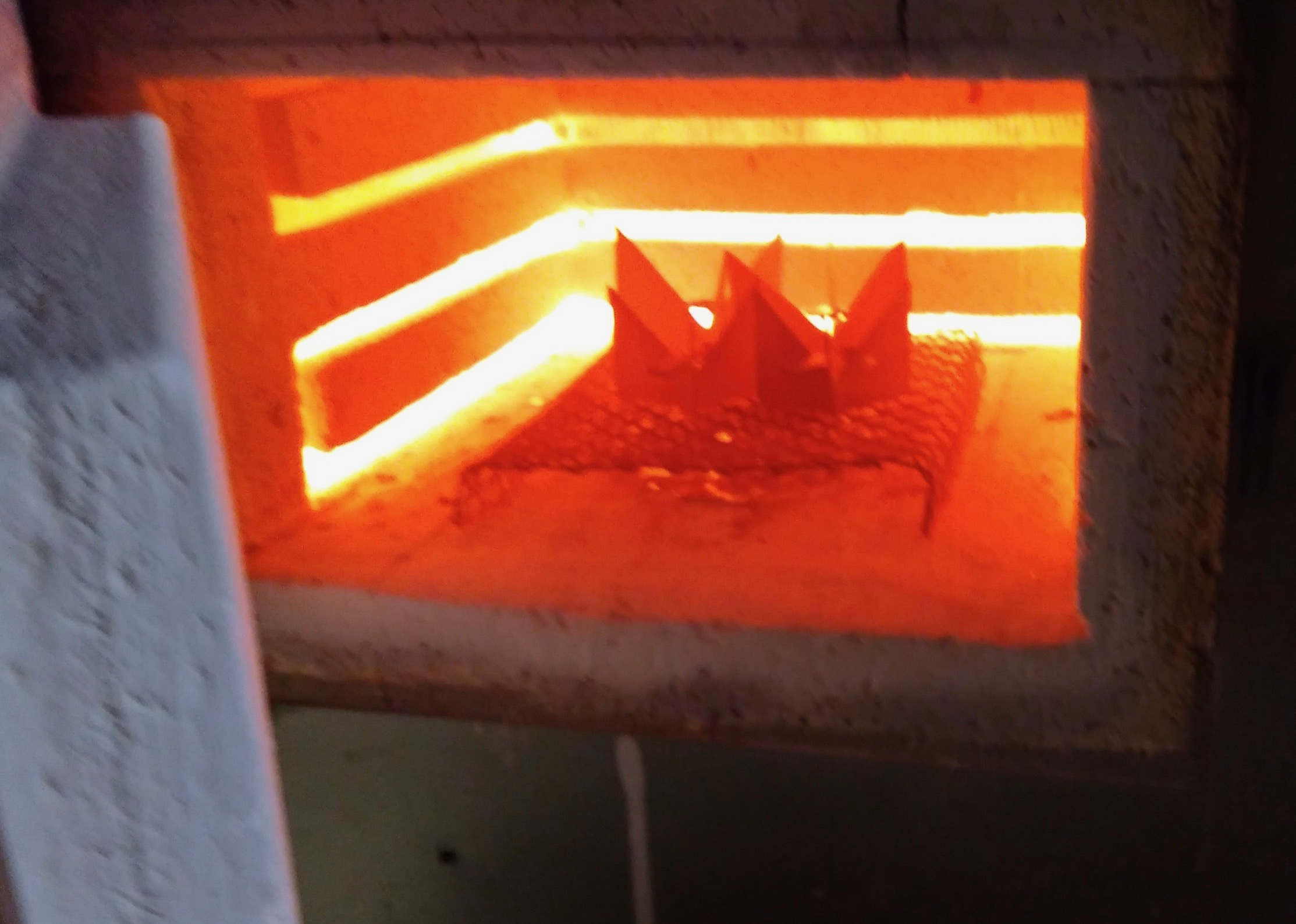 enamel pieces being fired inside one of my kilns that my father used to use