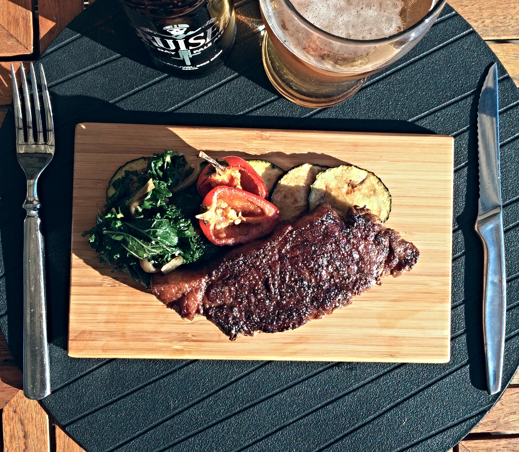 Chili Scented Pan Seared Sirloin Steak, with braised kale, and sautéed zucchini