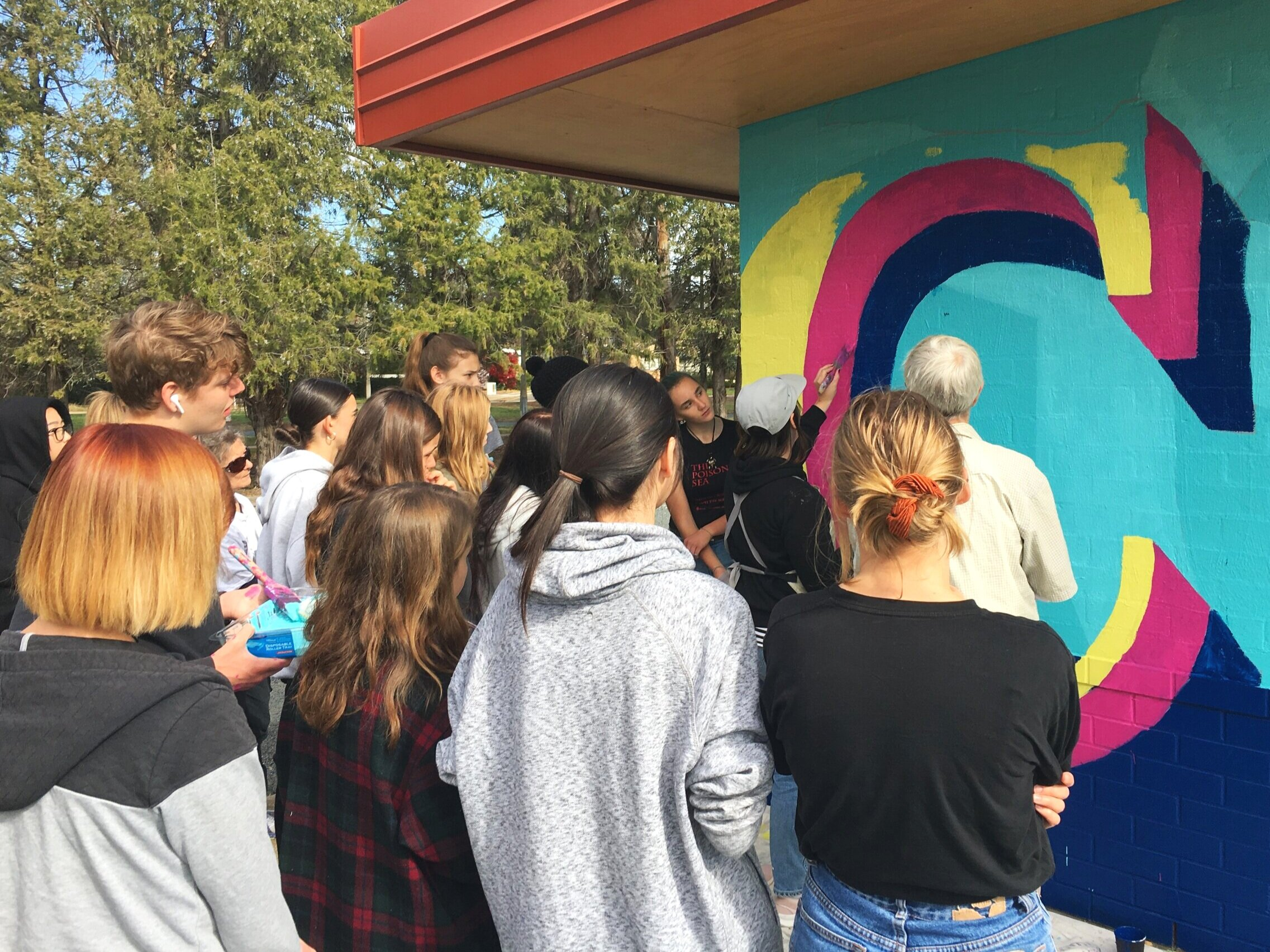 Giving a brush demo on a large scale mural project involving college students and the elderly in Narrabundah, ACT