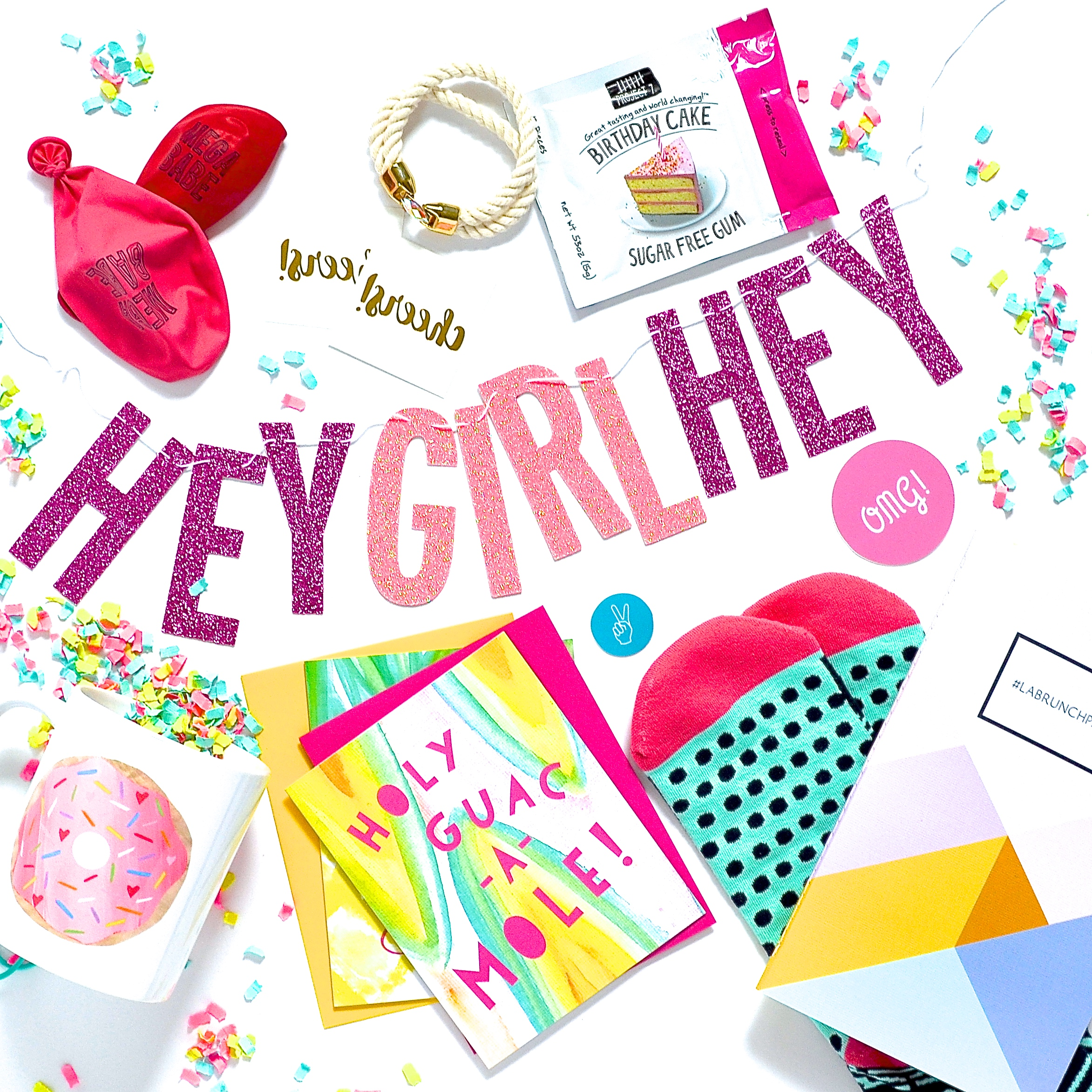 'Hey Girl Hey' Banner-   Dixie&Twine   // Custom Notebook-   May Designs   // 'Mega Babe' Balloons-   Little Arrow   // Rope Bracelet-   Allison Cole Jewelry   // Patterned Socks-   Woven Pear   // Gold 'Cheers' Tattoos-   Love & Lion   // Flavored Gum-   Project 7   // Donut Mug-   Lishy Lishy Home   // Stationery + Stickers-   Violet Tinder