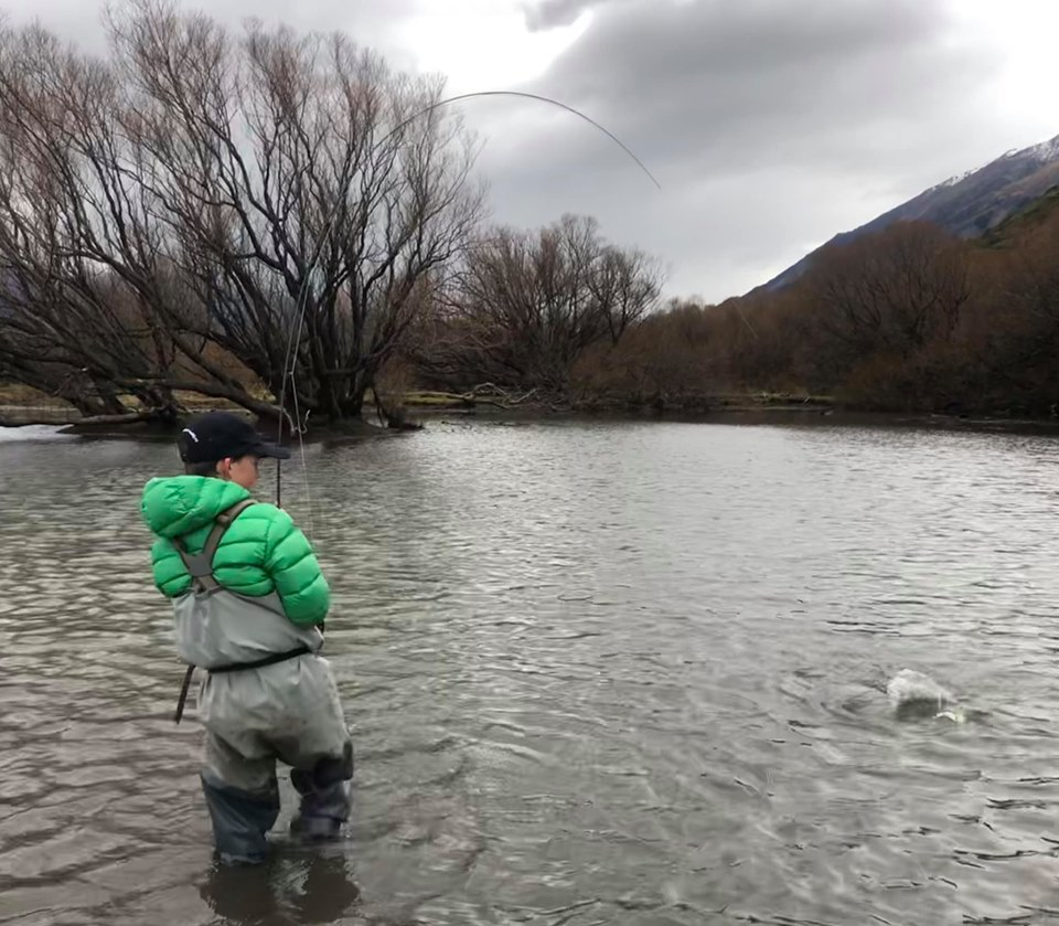 My son Louie attached to a mid winter blood worm muncher from Lake Wanaka.