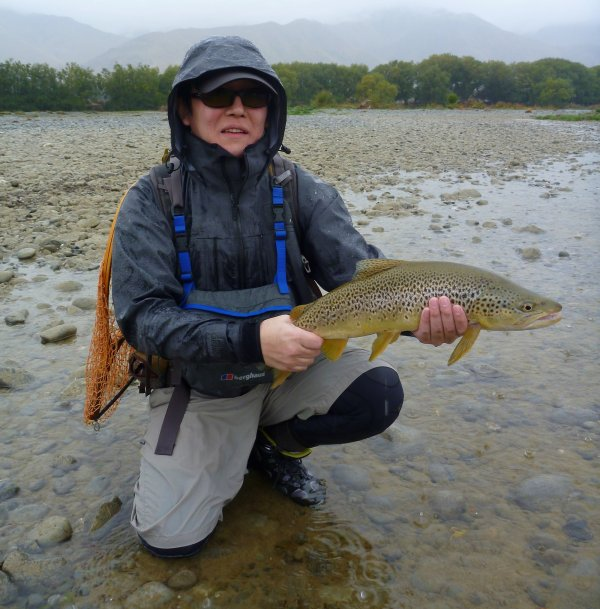 Norio with a good fish from a small back water on a #16 blood worm that was suspended under a small parachute style dry fly.