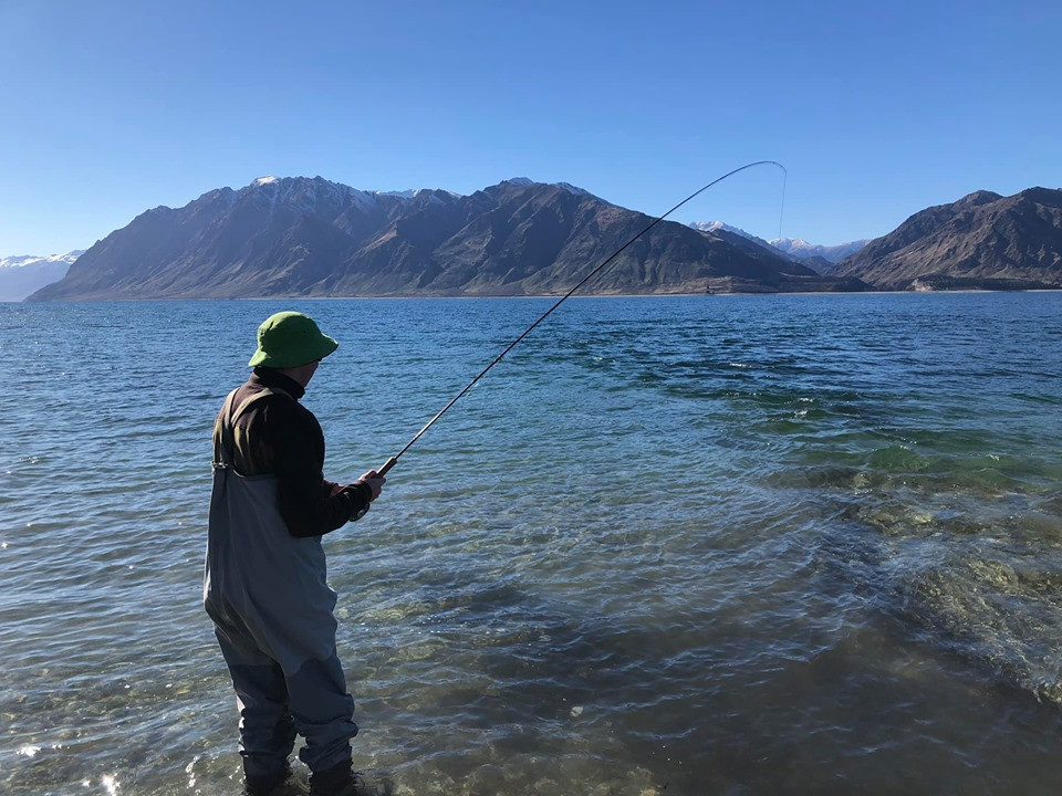 Morris into his first fish on a fly rod