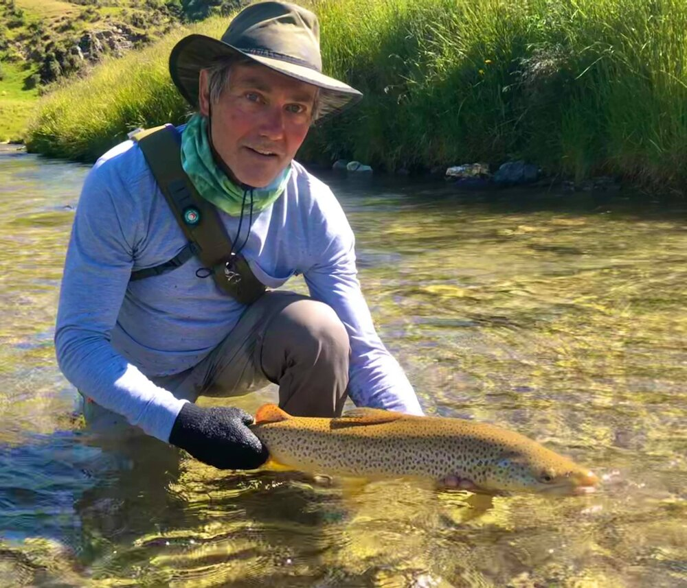 Luke with a stunning green beetle muncher from an early season guide day.