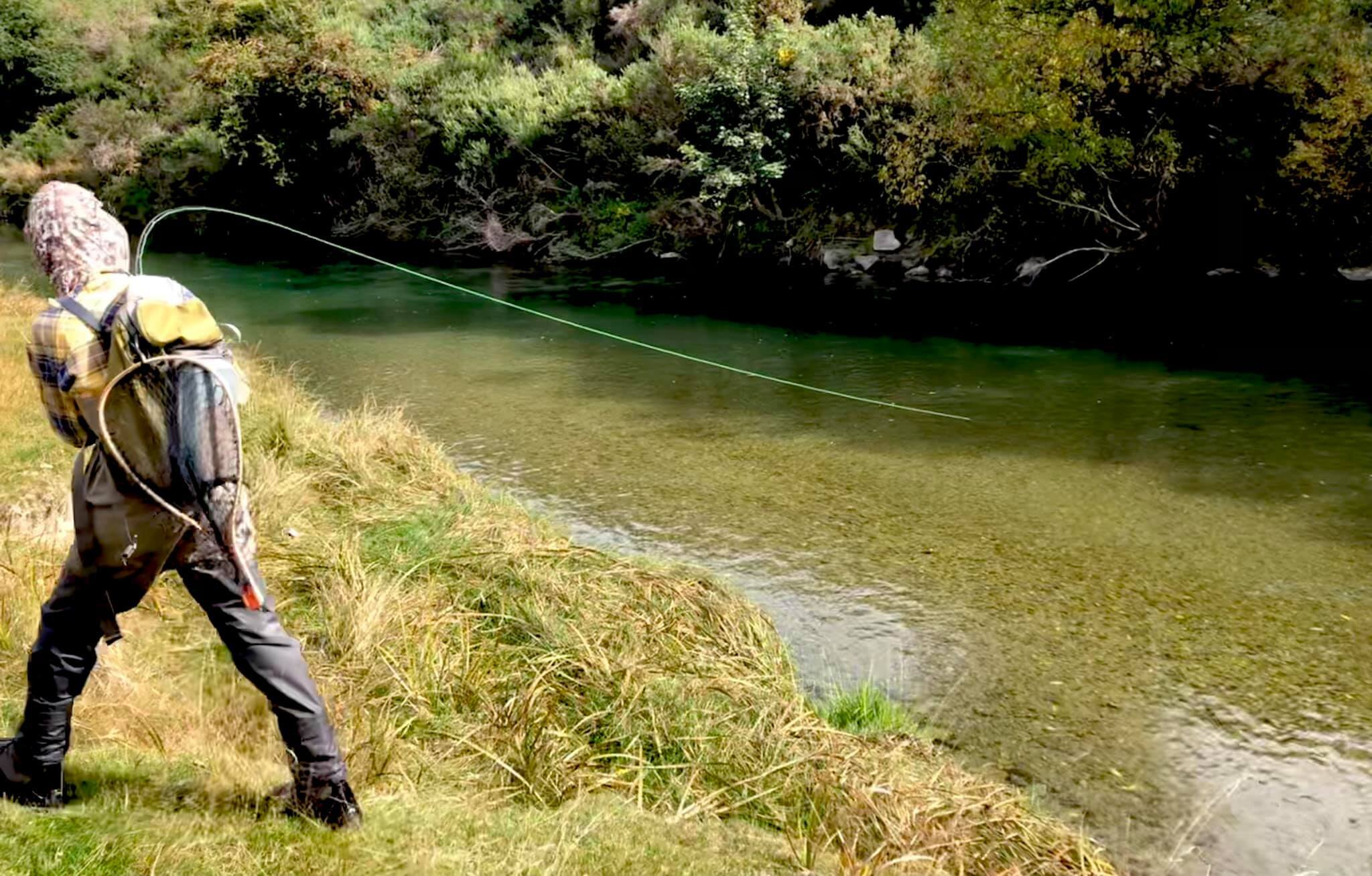 Louie standing his ground attached to another superb brown trout on the Mataura river - Southland New Zealand