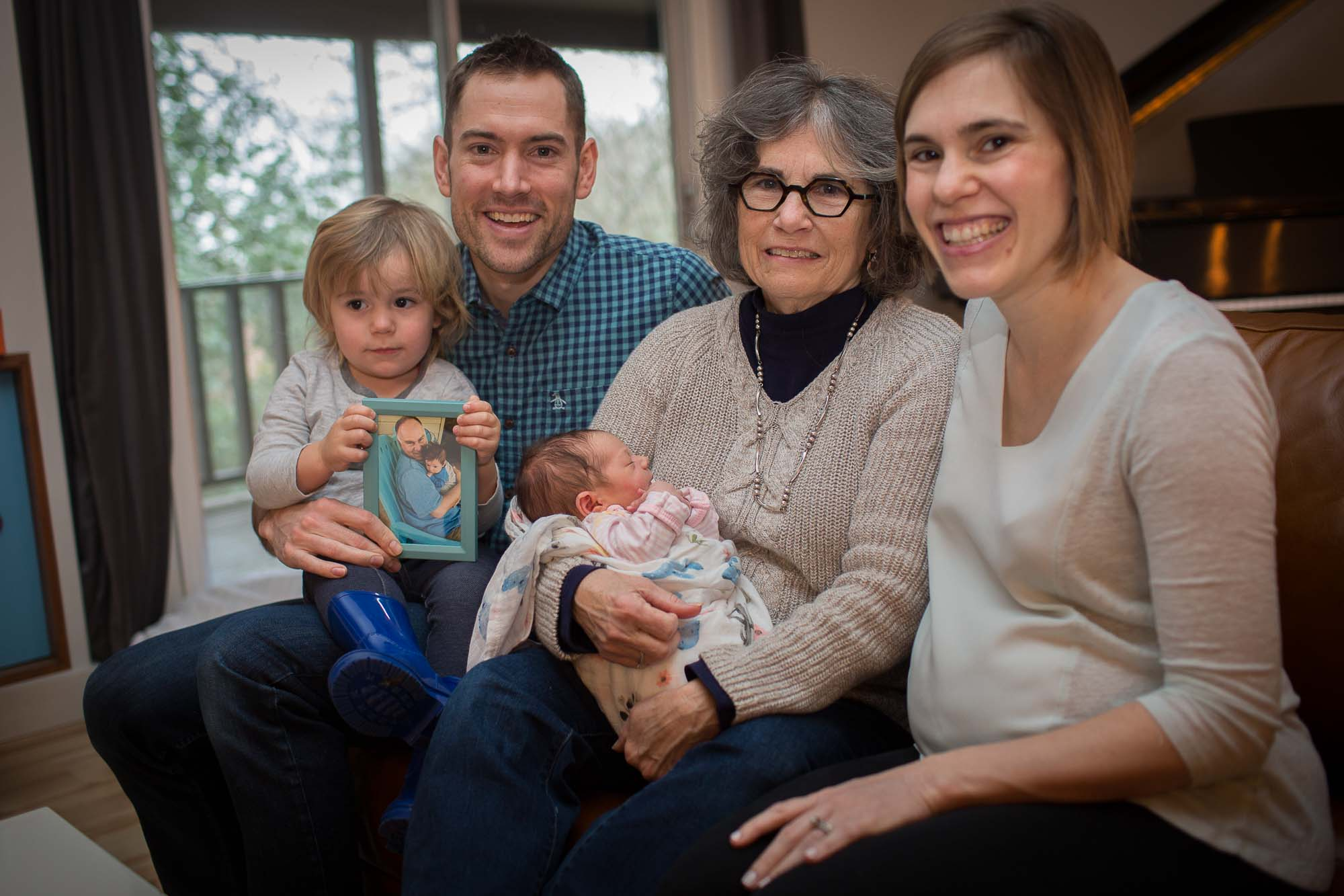 The family together with a picture of Keris's father. Austin newborn lifestyle photography.