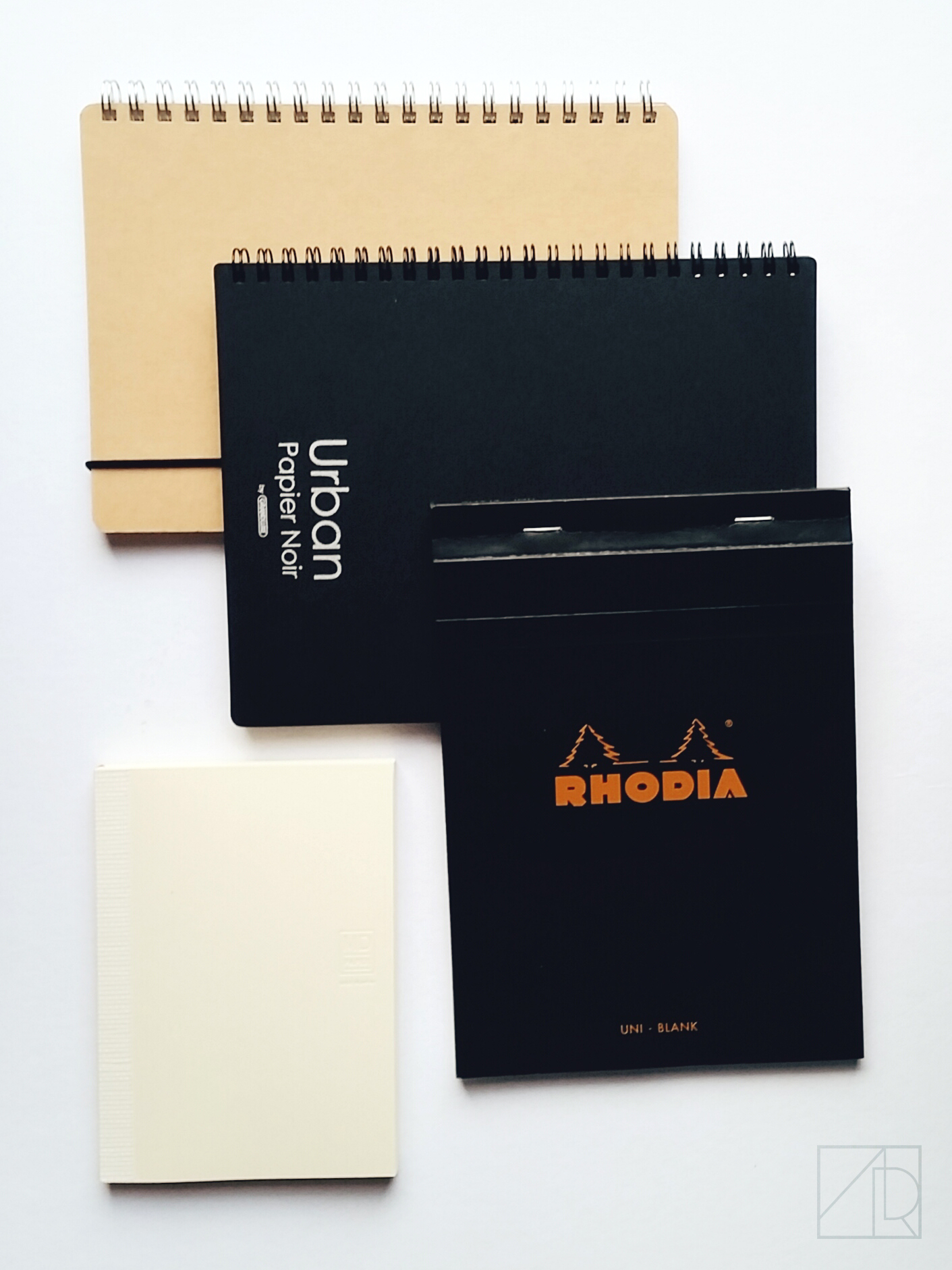 Muji Dotted Notebook, Urban Papier Noir, Rhodia Uni Blank, Midori Pocket Notebook.